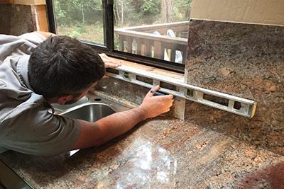 Man repairing countertop